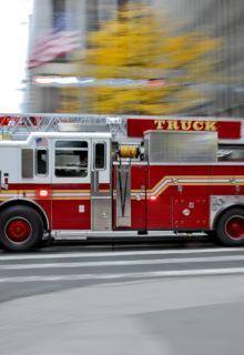 fire truck driving through a city